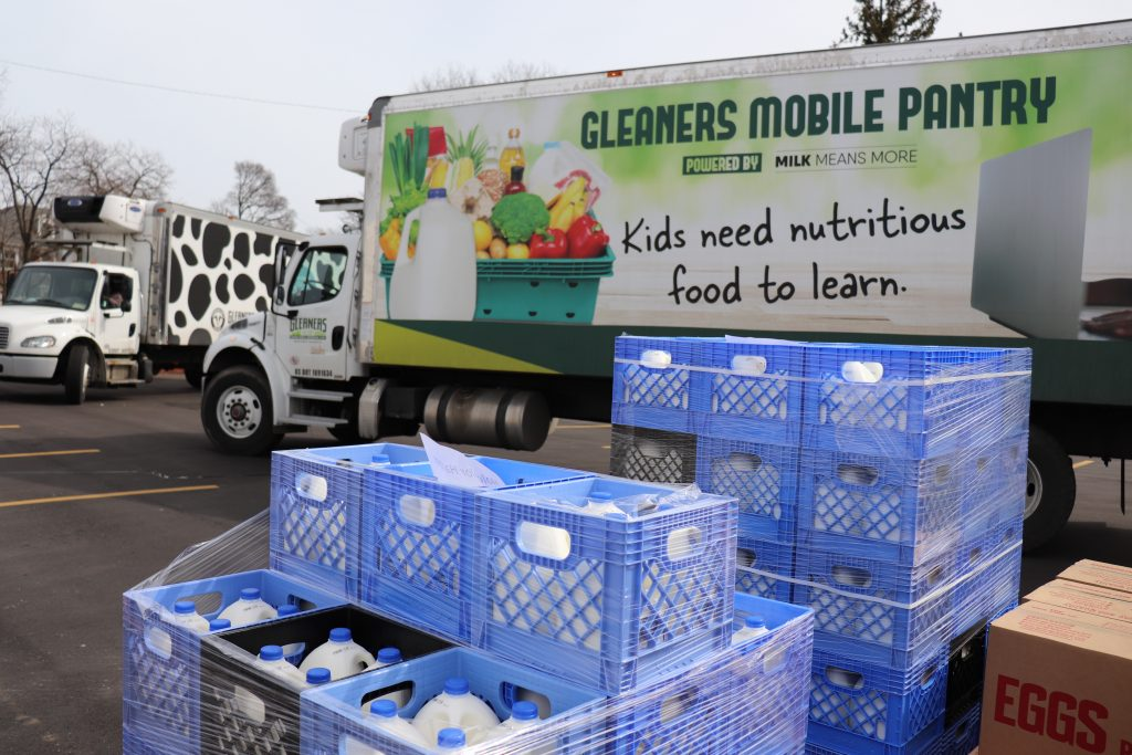 Gleaner's Mobile Pantry truck passing out gallons of milk in a spirit of giving.
